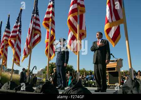 U.S. Defense Secretary Ash Carter and Air Force Gen. Paul Selva stand for the national anthem during a ceremony - Stock Photo