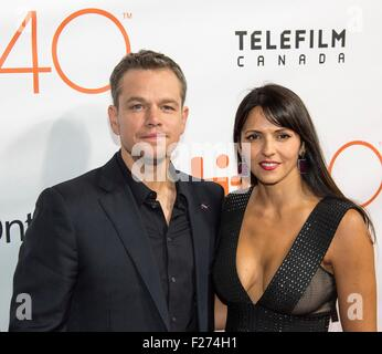 Actor Matt Damon and his wife Luciana Bozan Barroso attend the world premiere for The Martian at the Toronto International - Stock Photo