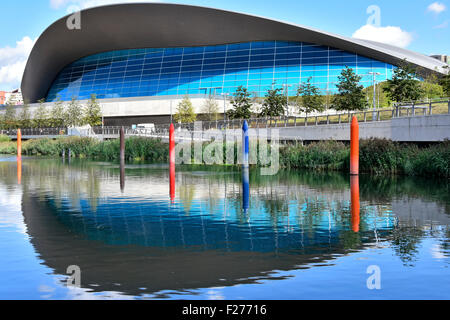 London Aquatics Centre by architect Zaha Hadi & Waterworks River Steles sculptures in Queen Elizabeth Olympic Park - Stock Photo