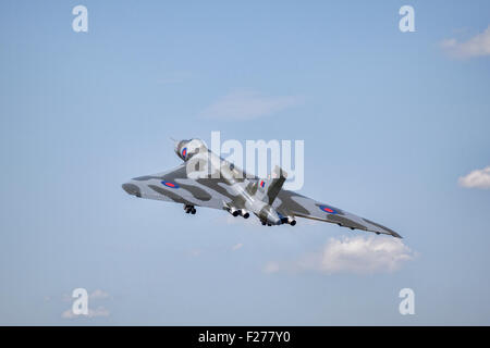 The last flying Avro Vulcan B2 bomber aircraft climbing after takeoff at RIAT 2015, at Fairford, Gloucestershire. - Stock Photo