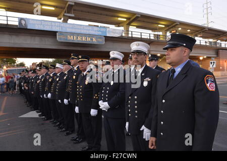 Merrick, New York, USA. 11th September 2015. Firefighters from Merrick and New York City stand in line during Merrick - Stock Photo