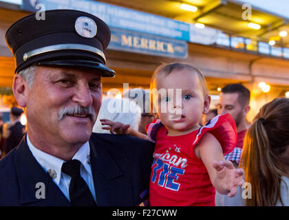 Merrick, New York, USA. 11th September 2015. RILEY E. GIES, one-year-old granddaughter of Fire Chief Ronnie E Gies - Stock Photo