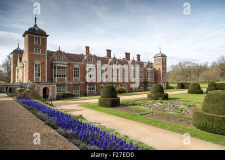 Blickling Hall Norfolk UK. Hyacinth bed in foreground - Stock Photo