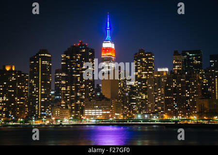 View of the Empire State Building from Gantry Plaza State Park, in Long Island City, Queens, New York. - Stock Photo