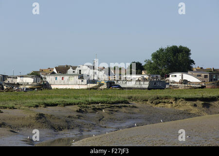 Houseboats on the mudflats on the banks of the river Adur in Shoreham West Sussex. - Stock Photo
