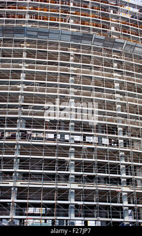 Scaffolding Covering a Building under construction - Stock Photo