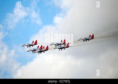 ZHUKOVSKY, RUSSIA - AUG 30, 2015: Aerobatic teams Swifts (Strizhi) on planes MiG-29 on the International Aviation - Stock Photo