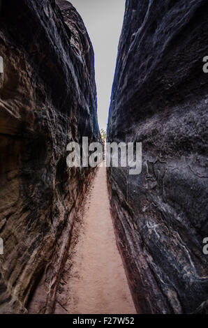 Fisheye view through a  narrow slot canyon in Canyonlands National Park - Stock Photo