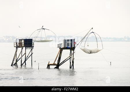 Traditional carrelet lift net fishing hut. Saint-Michel-Chef-Chef beach, Loire-Atlantique, France. Plaice smelt - Stock Photo