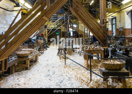 Interior of Stott Park Bobbin Mill preserved and working to demonstrate manufacture of wooden bobbins for the textile - Stock Photo