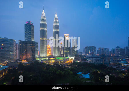 he petronas twin towers klcc at sunset blue hour seen from the traders skybar - Stock Photo