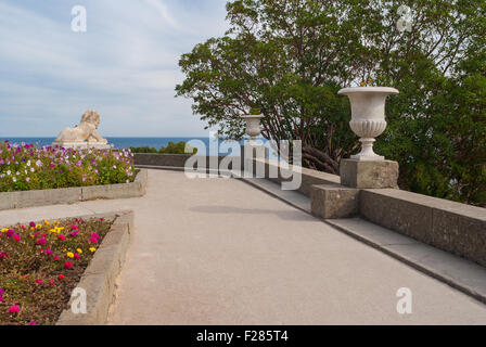 View from path in the Vorontsovsky Park to Black Sea, in the town of Alupka in Crimean peninsula - Stock Photo