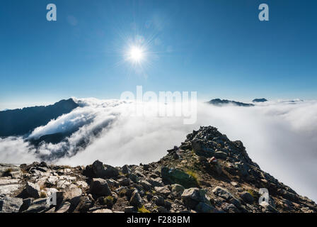 Clouds passing over the mountain ridge, view from Greifenberg at 2618m, Rohrmoss-Untertal, Schladming Tauern, Alps, - Stock Photo