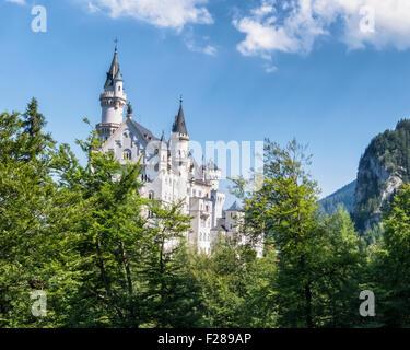 Neuschwanstein castle, schloss, Gothic palace built by King Ludwig ll above Hohenschwangaü Village, Schwangau, Bavaria, - Stock Photo