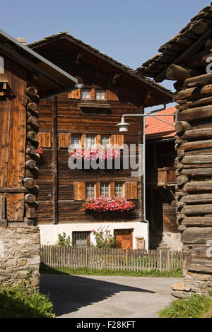 Log cabins in a village, Vrin, Switzerland - Stock Photo