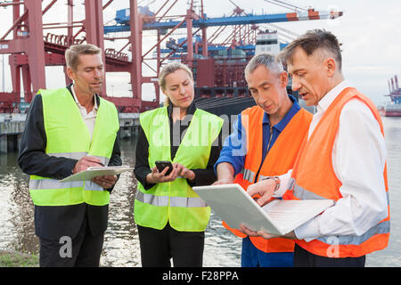 Business people working at harbour, Hamburg, Germany - Stock Photo