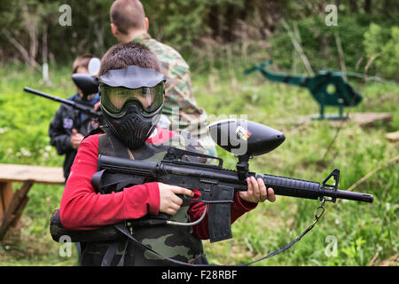 Paintball game on a special testing ground in spring forest. Vitebsk, Belarus 2015 - Stock Photo