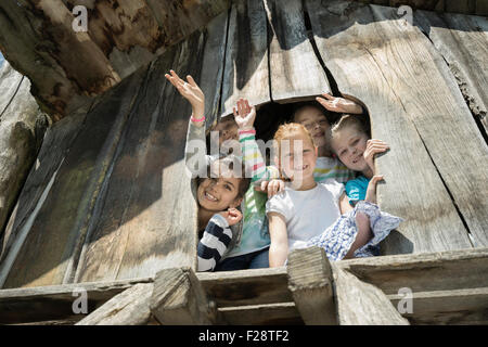 Girls playing on tree house in playground, Munich, Bavaria, Germany - Stock Photo