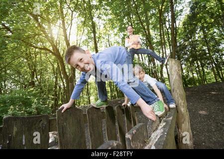 Three friends having fun in playground, Munich, Bavaria, Germany - Stock Photo