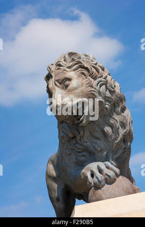 Statue Of A Roaring Male Lion On A Plinth In Front Of The