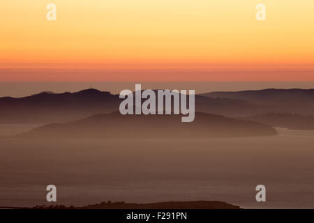 Hazy sunset over Angel Island and the Marin Hills. Golden-Gate National Recreation Area, California, USA. - Stock Photo