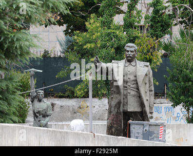 Statues of Joseph Stalin and a worker banished from prominent positions in Tirana to a yard behind the National - Stock Photo