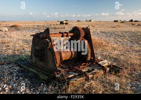 Old abandoned winch machinery on the shingle beach at Dungeness, Kent, England, UK - Stock Photo