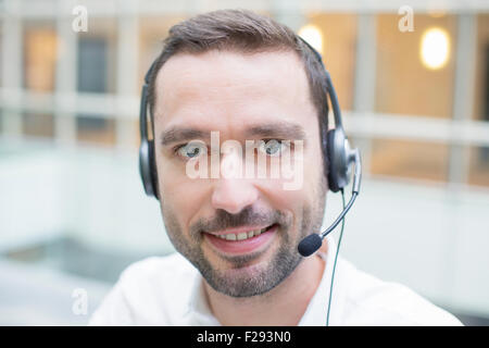 businessman using a headset - Stock Photo