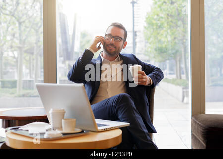 Businessman having a coffee break - Stock Photo