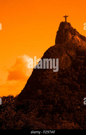Scenic view of Christ the Redeemer statue and Corcovado mountain at sunset, Rio de Janeiro, Brazil. - Stock Photo
