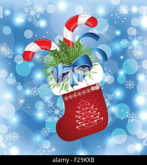 Christmas sock with sweet canes - Stock Photo