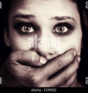 Scared woman victim of domestic torture and violence - Stock Photo