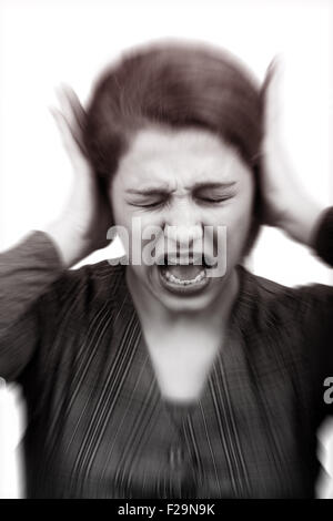 Noise and stress concept - woman covering her ears - Stock Photo