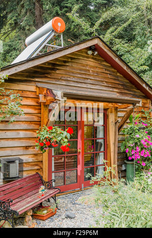 Cabin with solar water heater on roof, Sailboats, Sunshine Coast, ,British Columbia, Canada - Stock Photo