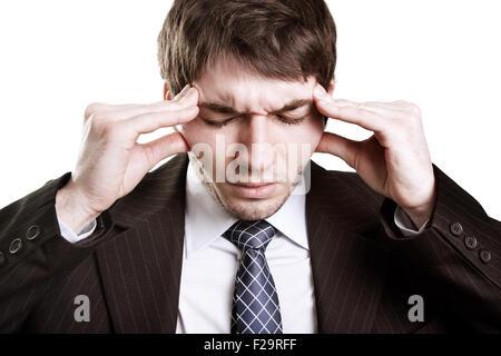 Tired stressed businessman having a big headache - Stock Photo