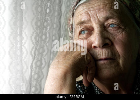Elder senior woman with sad face suffering from depression - Stock Photo