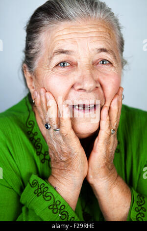 Happy and amazed old senior lady - Stock Photo