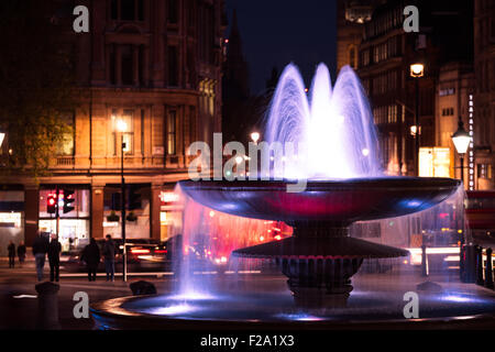 A fountain in Trafalgar square, London, taken in Spring. - Stock Photo