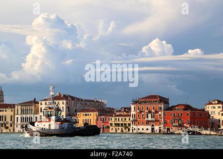 Cloud formations at Fondamenta delle Zattere waterfront.  Tug 'Giulia C',  IMO 9364514 - Stock Photo
