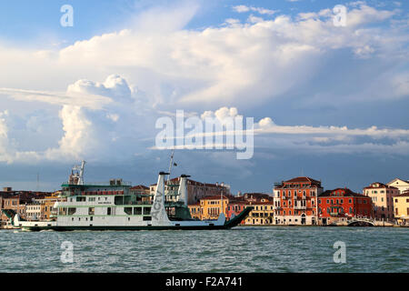 Cloud formations at Fondamenta delle Zattere waterfront. Actv ferry 'San Nicolo', IMO  9198422, going from Tronchetto - Stock Photo