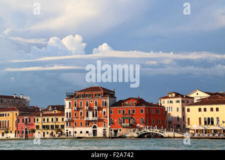 Cloud formations at Fondamenta delle Zattere waterfront - Stock Photo