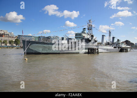 HMS belfast on the banks of the river thames in london - Stock Photo