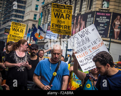 31st August 2013: Protesters against America entering a war with Syria on 6th Avenue, Manhattan, New York, USA. - Stock Photo
