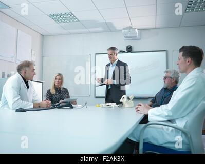 Medical product designers in presentation about orthopaedic product designs - Stock Photo