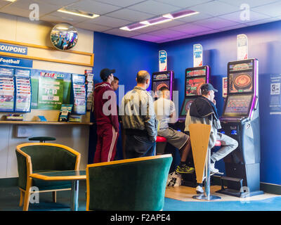 Fixed odds gaming machines (FOBT fixed odds betting terminal) in Bet Fred Betting shop. UK - Stock Photo