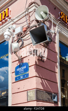 Surveillance cameras and loudspeakers on the corner of the building - Stock Photo