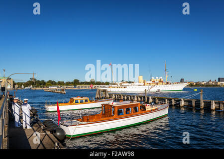 The Royal Yacht Dannebrog and supporting boats in Copenhagen Harbor, Denmark - Stock Photo
