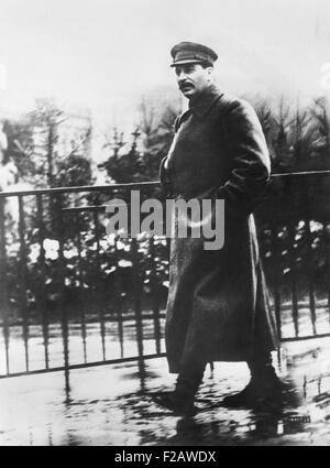 Comrade Josef Stalin, Premier of the Soviet Union, strolling in Red Square in a Spring rain. Moscow, May 18, 1932. - Stock Photo