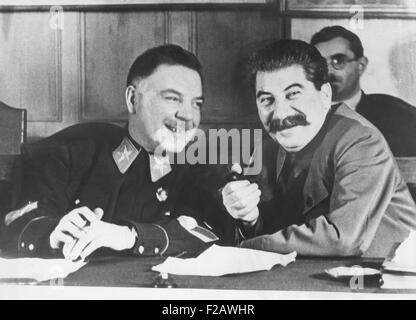 Josef Stalin (left), and Kliment Voroshilov, the Soviet's Chief War Minister, in 1936. Voroshilov relations with - Stock Photo