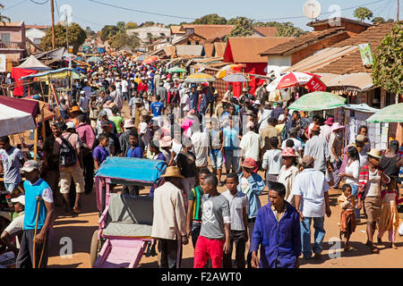 Malagasy people on busy weekly market in rural village near Antsirabe, Vakinankaratra, Madagascar, Southeast Africa - Stock Photo